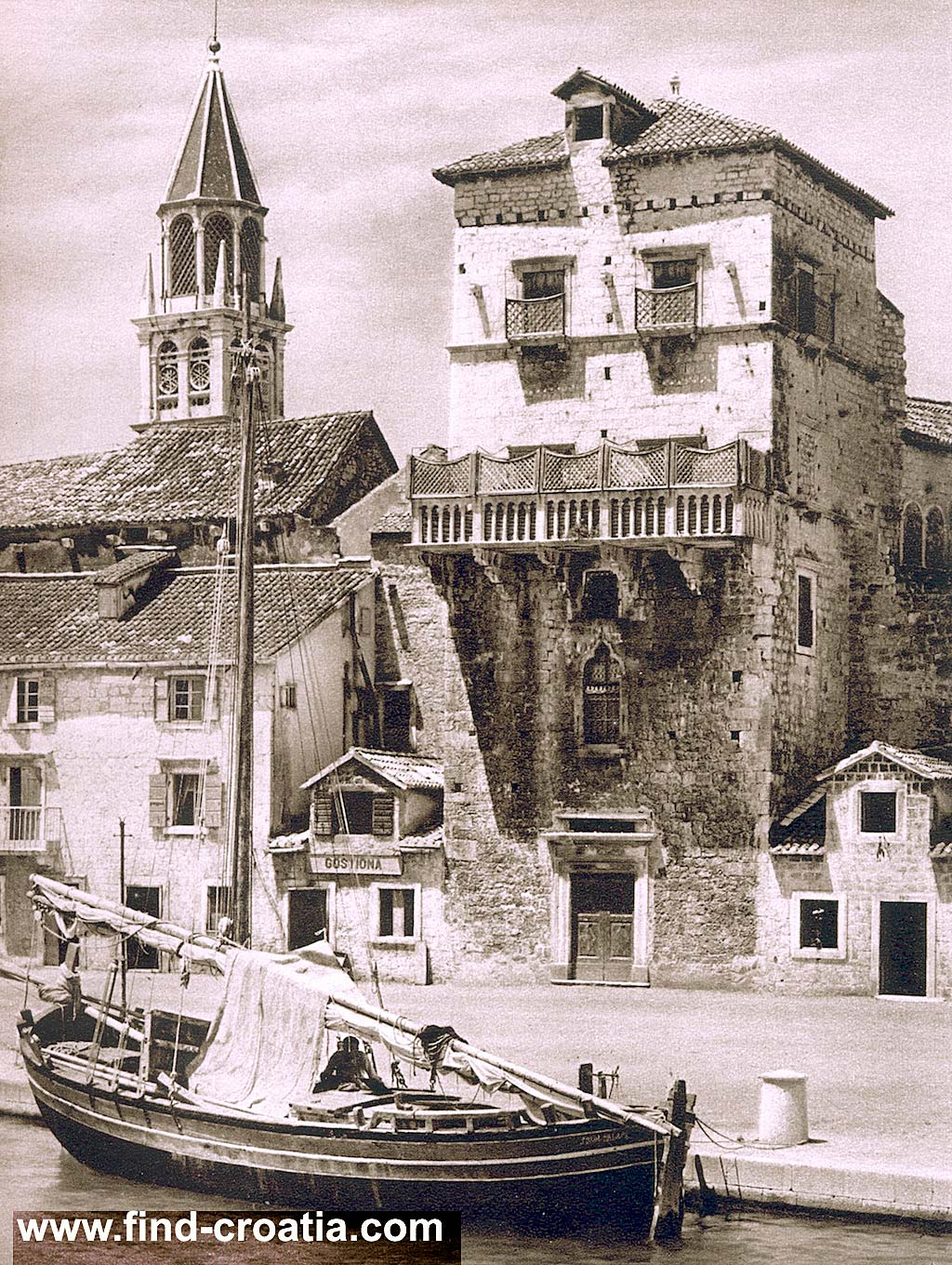 Traditional wooden boat in Trogir harbour in 1920s